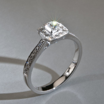 18ct W/G Princess Cut & Brilliant Cut Diamond Halo Ring