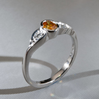 Platinum Fancy Orange Oval & Brilliant Cut Diamond Ring